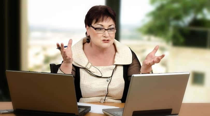 Frustrated Mature Female with laptop